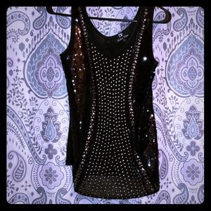 Dulcci Vetan sheer solid black tank.